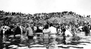 Calvary Chapel reached out to the hippies in the 60s and 70s. Here's an photo of one of its mass baptisms.